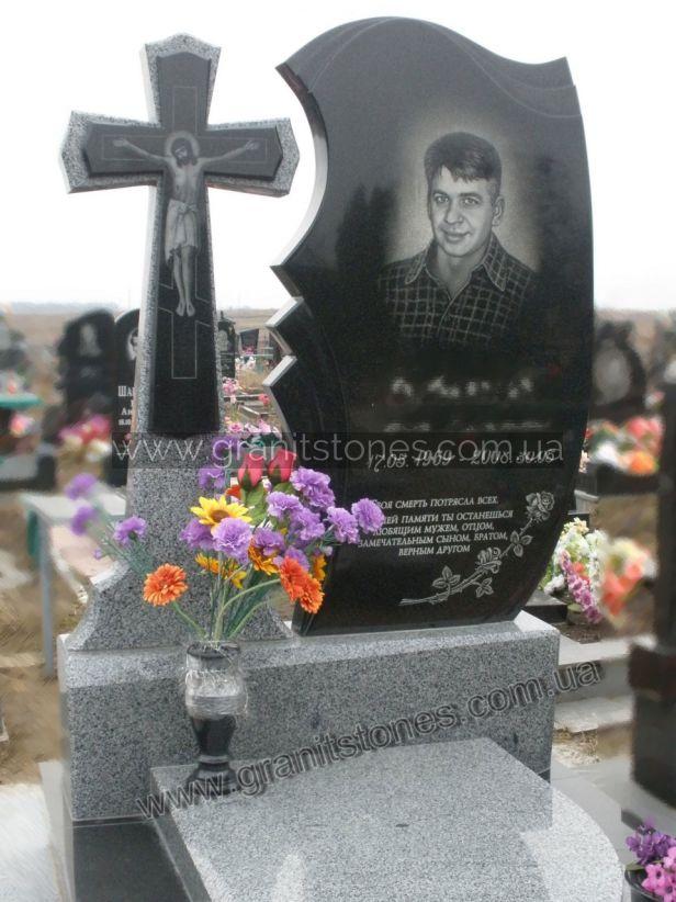 Памятник из гранита с крестом и вазой