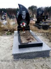 Памятник в виде огонька на могилу